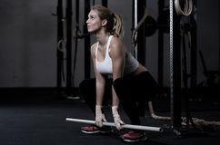 Working out with lever. At the gym Stock Photos