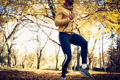 Working out in nature. On the move. Sporty young man Stock Photo
