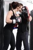 Working out with the pads Stock Photography