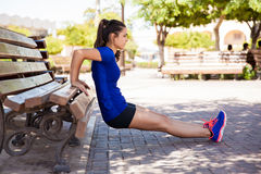Working out on a park bench royalty free stock image