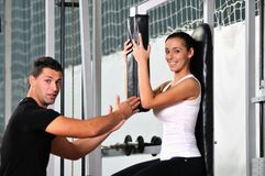 Working out with personal trainer Royalty Free Stock Image