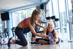 Working out with personal trainer Royalty Free Stock Photography