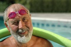 Working out in the pool. Fit senior man working out in the swimming pool Stock Images