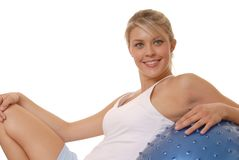 Working Out Seven. Lovely young girl working out with exercise ball stock photography