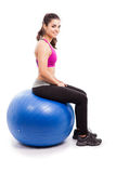 Working out on a stability ball Royalty Free Stock Images
