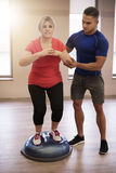 Working out with trainer stock image