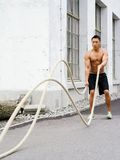 Working out with training ropes Royalty Free Stock Images