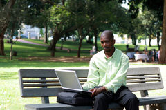 Working outdoors. An african businessman working outdoors Stock Images