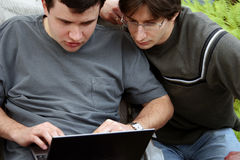 Working outdoors. 2 young men with laptop Stock Images