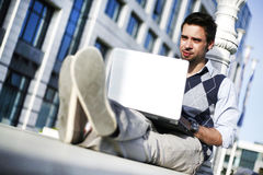 Working outside. Young man working on laptop outside Royalty Free Stock Images