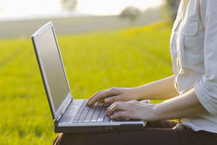 Working outside with laptop Royalty Free Stock Image