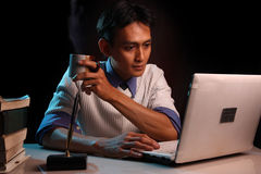 Working overtime. Portrait of man working overtime Royalty Free Stock Image