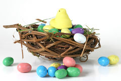 Working Overtime. A marshmallow peep works overtime to create candy eggs in this humorous depiction for Easter royalty free stock photography