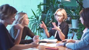Working overtime concept. Group of female business team working late at night stock footage