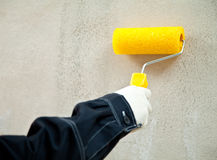 Working with paint roller Royalty Free Stock Photo