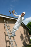 Working painter. A working house painter who tumbles the ladder Stock Images