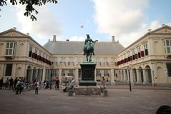 Working palace Noordeinde with statue of king willem 1 in the Hague, The Netherlands.  royalty free stock photography
