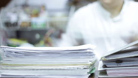 Working papers document in office stock footage