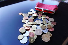 Working for pennies. Pennies on a table salary Royalty Free Stock Photography