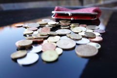 Working for pennies. Pennies on a table salary Stock Photography