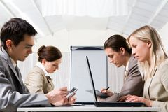 Working people. Two rows of businesspeople working at briefing opposite each other stock photos