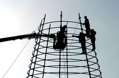 Working people on height. Working people on prefabricated elements stock photos