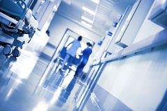Working people in the hospital hallway royalty free stock photography