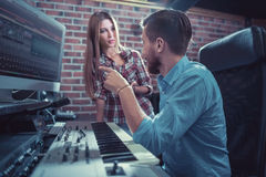 Working people. Producer and singer in recording studio royalty free stock photography