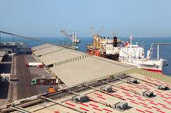 Working people ship cargo boats at port Royalty Free Stock Photography