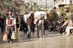 MG Marg Gangtok Sikkim India December, 26, 2018: Working people walking in the busy MG Marg street. Selective Focus royalty free stock photos