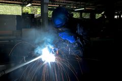 Working person About welder steel Using electric welding stock images