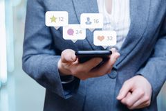Working with phone in social media. royalty free stock image