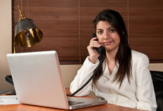 Working the phones Royalty Free Stock Photos