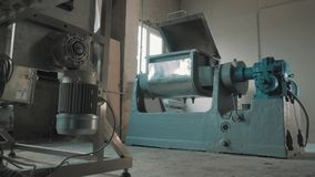 Working piece of machinery with open lid at empty bright manufactory. Working grey and blue metal industrial piece of machinery with open lid at empty bright stock video