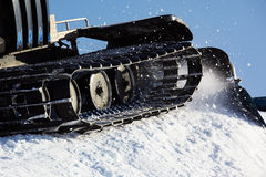 Working Piste machine (snow cat) detail Royalty Free Stock Image