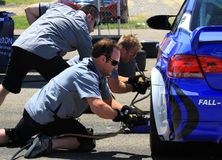 Working pit crew team Royalty Free Stock Photo
