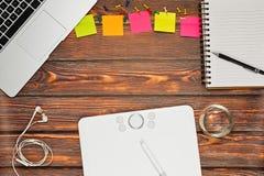 Designer or illustrator working space. Working place of designer or illustrator captured in top view. Graphics tablet, professional laptop, sketchbook, earphones Stock Photos