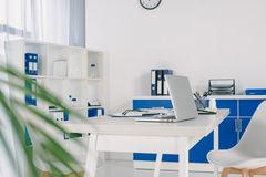 Working place with laptop on table. In clinic stock photography
