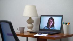 Working place with laptop transmitting online course for distance education
