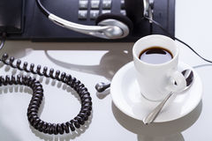 Working place office desk table headset glasses telephone Royalty Free Stock Image