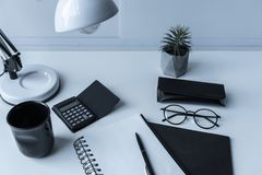 Working place with table lamp. And plant stock images