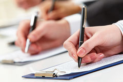 Working at plan. Close-up of business person hand working with document Royalty Free Stock Image