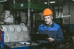 Working in the plant with tablet in hands on the background of t stock images