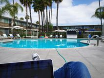 Working by the Pool Royalty Free Stock Photo