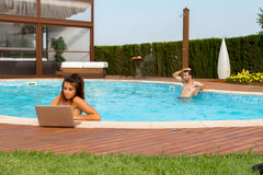 Working in a pool Stock Photo