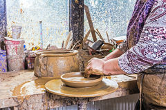 Working at pottery wheel Royalty Free Stock Images