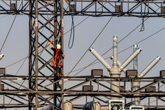 Working on a power poles Stock Images