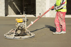 Working power trowel machine on a fresh concrete surface Stock Images