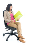 Working pregnant Asian business woman Royalty Free Stock Photo
