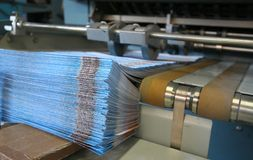 Working print machine. Colored brochures on working print machine - Others in my gallery stock image